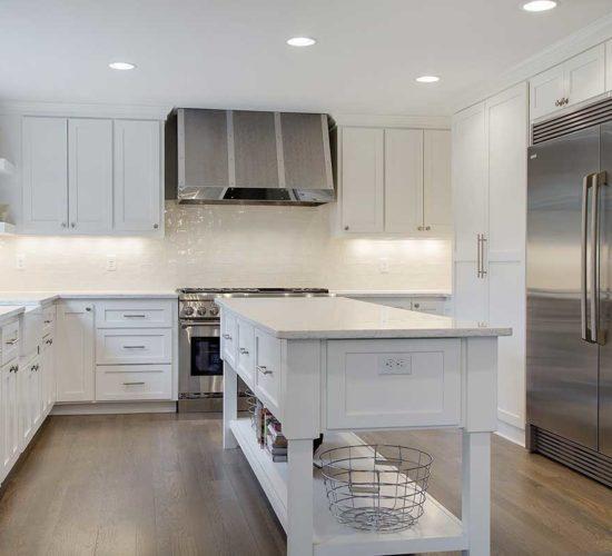 After photo of white kitchen with subway tile backsplash