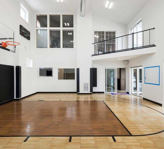 After photo of indoor sport court with overlook balcony